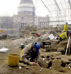 A photograph of an excavation in progress at Paternoster Square with St Paul's Cathedral in the background. Follow this link to the Archaeology Service website